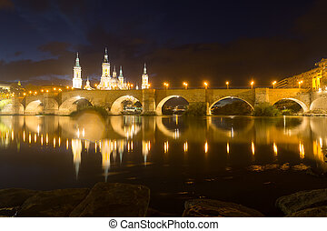 Cathedral of Our Lady of the Pillar and Ebro river in night