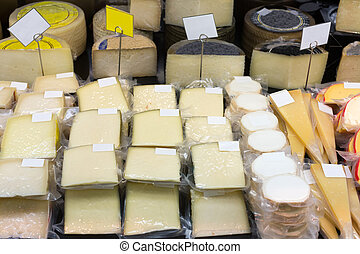 Fresh cheese in packs and in bulk on counter at store