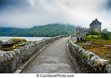 View of Eileen Donan Castle, Scotland in cloudy day with...
