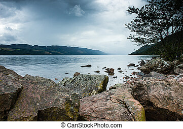 View of Loch ness Lake in Scotland, cloudy dramatic light