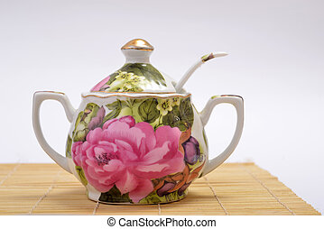 porcelain Sugar Bowl - Porcelain sugar bowl standing on...