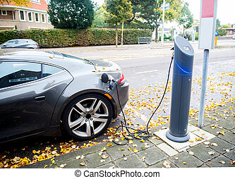 electric car - Close up of the power supply plugged into an...