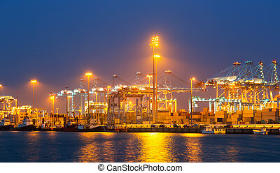 night view of with cranes and containers in port Algeciras,...