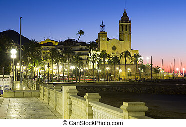 Dawn view of Sitges. Church of Sant Bartomeu i Santa Tecla...