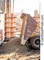 Dumper truck unloading construction gravel, granite and...