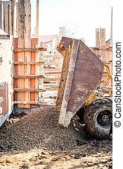 Dumper truck unloading construction gravel, granite and...