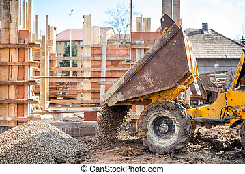 industrial truck loader excavating gravel and construction...