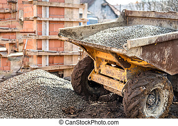 Dumper truck unloading construction gravel, sand and curshed...