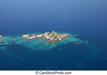 aerial view of the island with a chapel