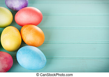 Dyed Easter eggs on a wooden panel