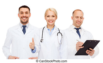 group of doctors showing thumbs up over white - healthcare,...