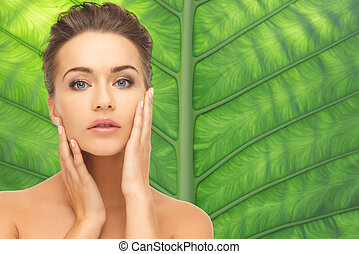beautiful young woman face over green background - beauty,...