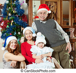 family with little girl in santa hats
