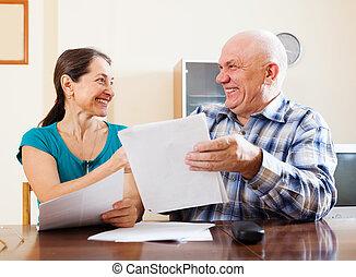 Happy senior couple with  documents