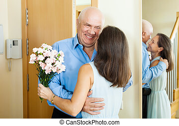 man came to woman with  flowers