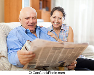 Portrait of laughing mature woman and elderly man with...