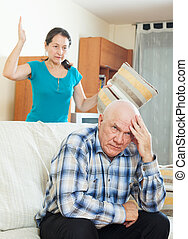 Upset mature man against angry woman - Family quarrel Upset...