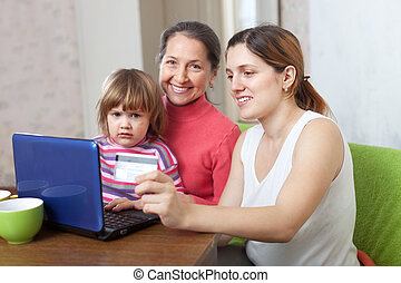 Happy family doing shopping in internet