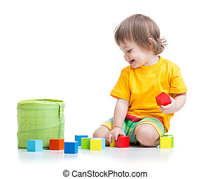 child boy playing wooden toys