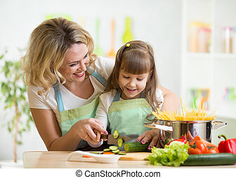 Mother teaches daughter cooking on kitchen - Cute mother...