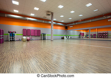 Interior of fitness room with large mirror