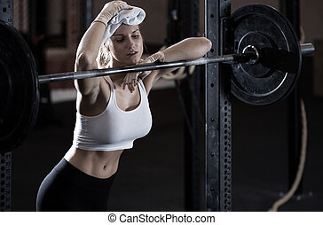 Weightlifting girl - Young exhausted weightlifting girl...