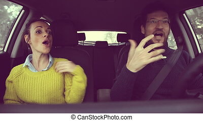 Man driving car with girlfriend tal