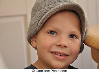 Cute 5 Year Old Boy Smiling - This closeup facial photo is a...