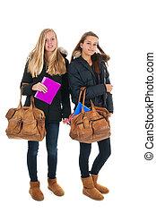 Schoolgirls with school bags - school girls walking at...