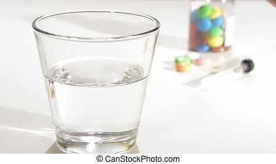 effervescent tablet in a glass of water, vitamin c