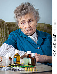 elderly woman - senior woman with her medicine bottles