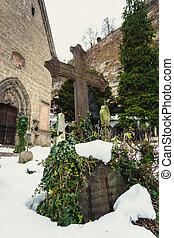 cross covered by snow on ancient graveyard at church - Big...