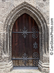 old oak door at ancient stone cathedral