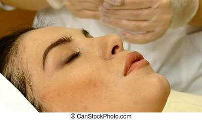 face cleaning in spa salon - Beautiful young female having...