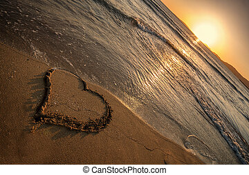 playa del arenal - sunset on a beach with a heart in the...