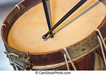 old military drum with black sticks - Closeup photo of old...