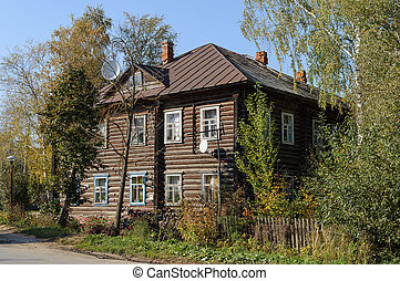 Old two-storey log house - Old two-storey wooden house in...