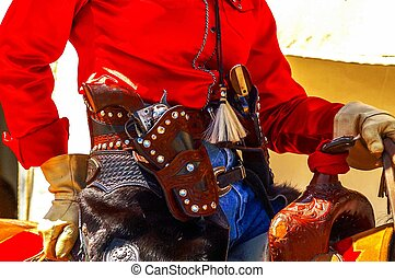 Cowgirl with sixguns, - Cowgirl reenactor in bright red...