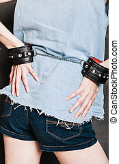 Arrest and jail Closeup handcuffs on female hands - Arrest...
