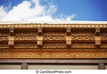 wood carving on the roof of tibetan