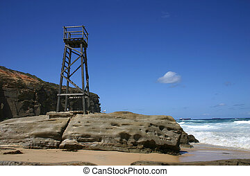 A wooden tower used to spot sharks on a rocky outcrop...