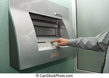 access to safe - businessman entering the bank safe or...