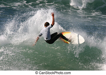 A surfer snaps off the top of the lip.