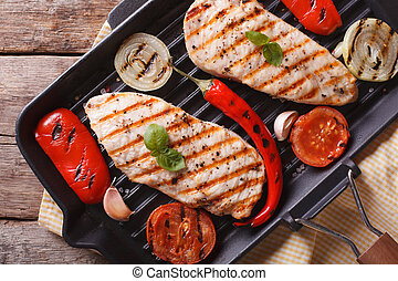 Chicken fillet with vegetables in pan horizontal top view