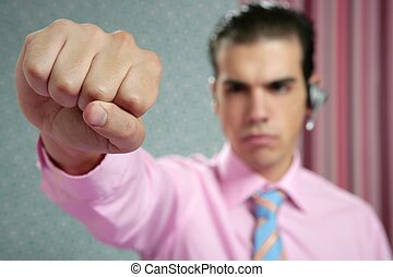 angry aggresive businessman with fist closeup to camera