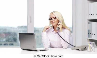 smiling businesswoman with laptop calling on phone -...