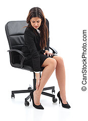 Businesswoman sitting and suffering feet ache isolated on a...