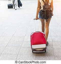 Young girl with red suitcase. Travel concept.