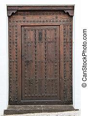 Old studded door - Old studded wooden door