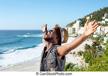 Happy african american man with arms outstretched - Portrait...